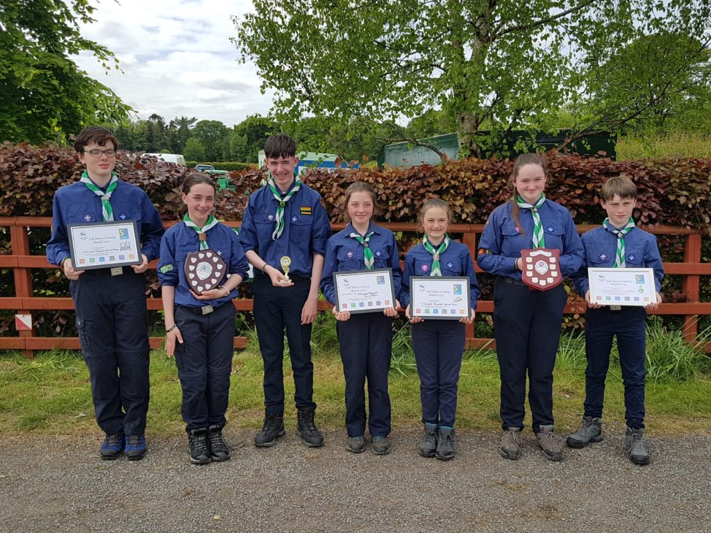Scouts holding two plaques and four certificates for their awards at county shield